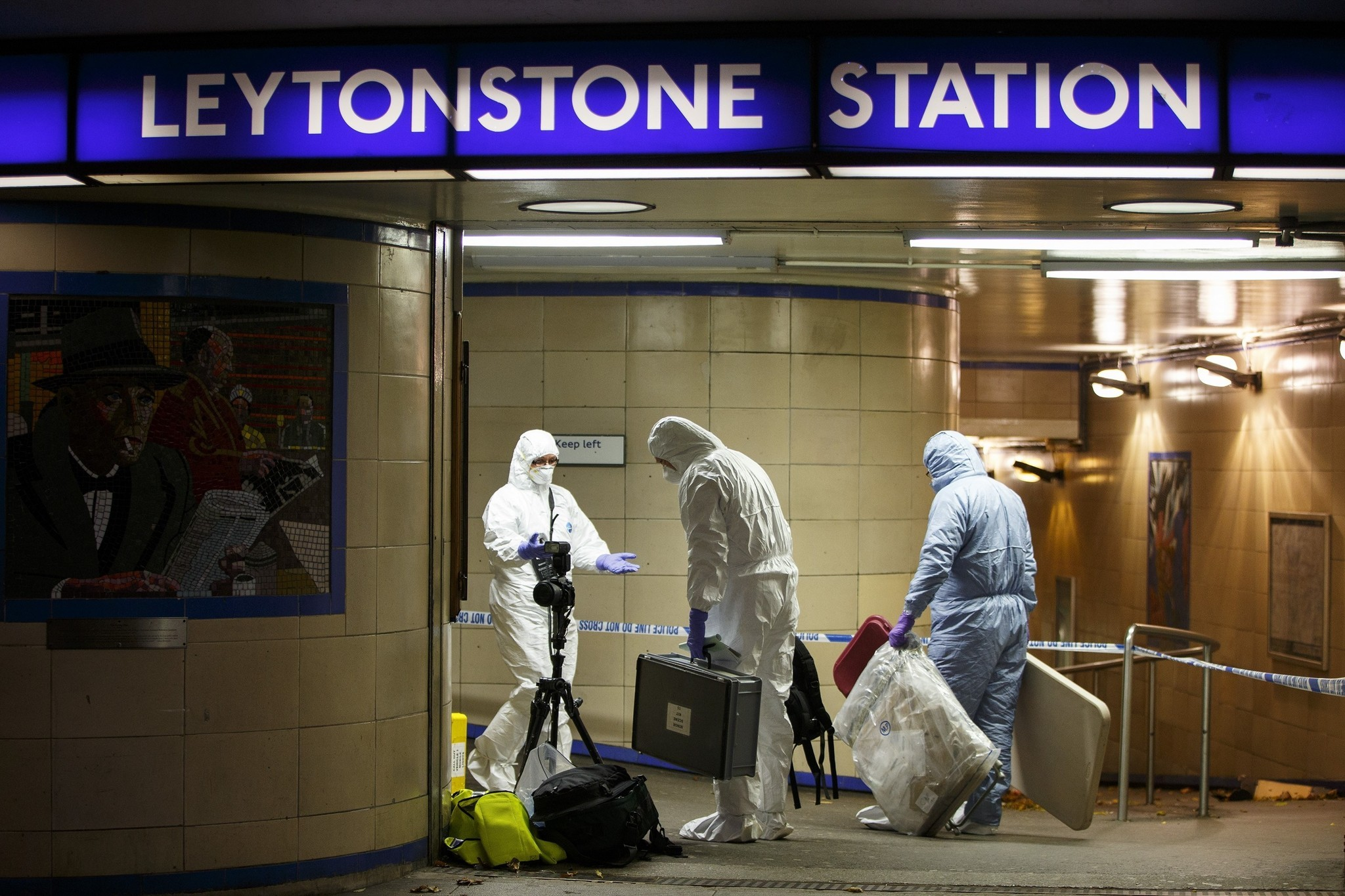 Crime scene investigators collect evidence at Leytonstone tube station in east London.