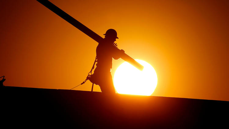 Homebuilder in Phoenix endures triple-digit heat.