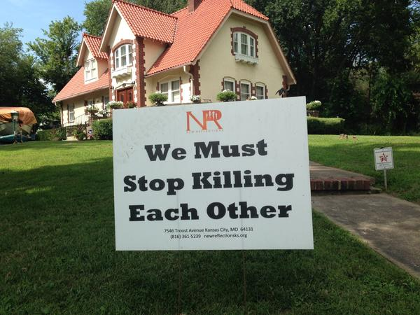 This anti-violence sign is found on many lawns in the Kansas City, Mo., neighborhood where gunman Gavin Long lived. (Louis Sahagun / Los Angeles Times)