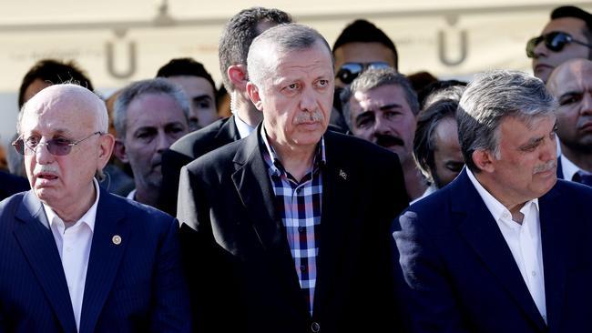 Turkish President Recep Tayyip Erdogan, center, along with the nation's current parliamentary speaker Ismail Kahraman, left, and former president Abdullah Gul. (Sedat Suna / EPA)