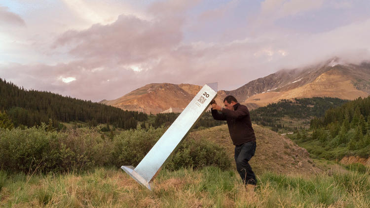 "Marcos Ramirez, known as ""ERRE,"" erects a monument to mark the 1821 U.S.-Mexico border north of Leadville, Colo. — a project now on view at MCASD."