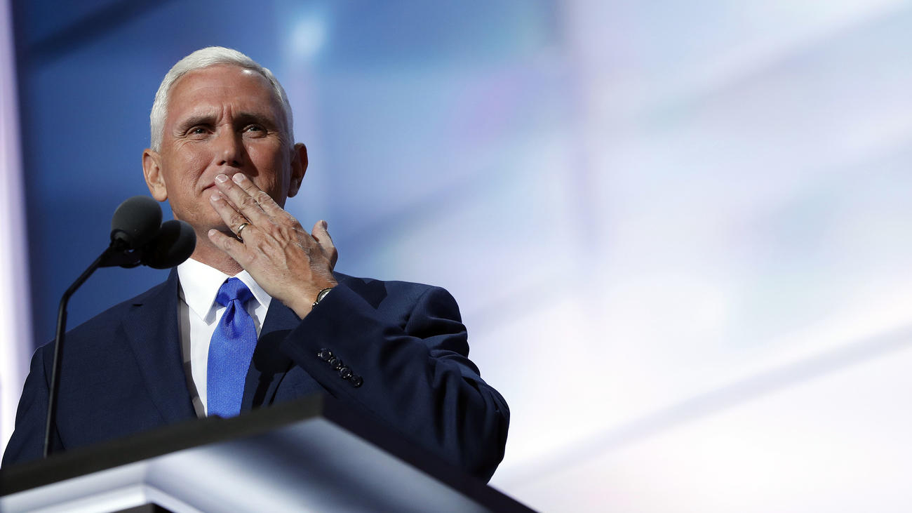 Republican vice presidential candidate Mike Pence blows a kiss to his wife as he speaks during the third day of the Republican convention. (Mary Altaffer / Associated Press)