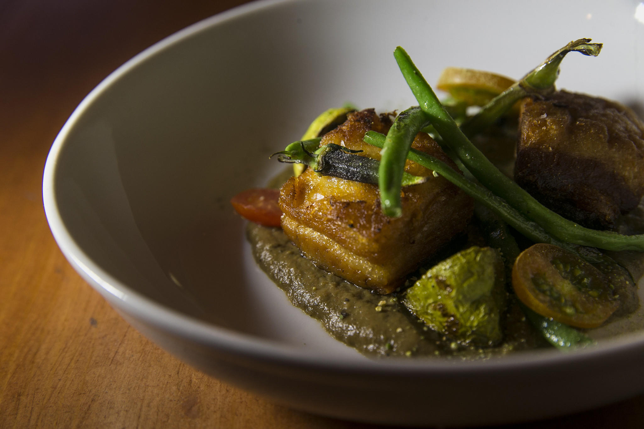 Lasa dish: twice-cooked pork belly with smoky eggplant, summer vegetables and ampalaya powder. (Robert Gauthier / Los Angeles Times)