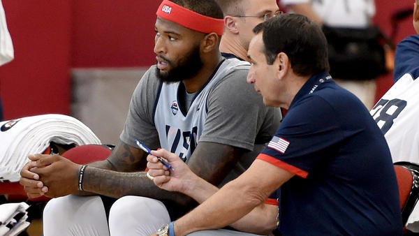 Coach Mike Krzyzewski, right, chats with center DeMarcus Cousins during a Team USA practice. (Ethan Miller / Getty Images)