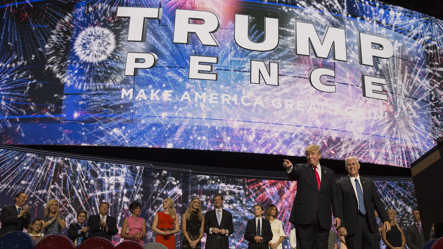 With their families behind them, Republican Presidential nominee Donald Trump and Vice Presidential nominee Mike Pence are cheered on by delegates at the close of the final day of the 2016 Republican National Convention in Cleveland.