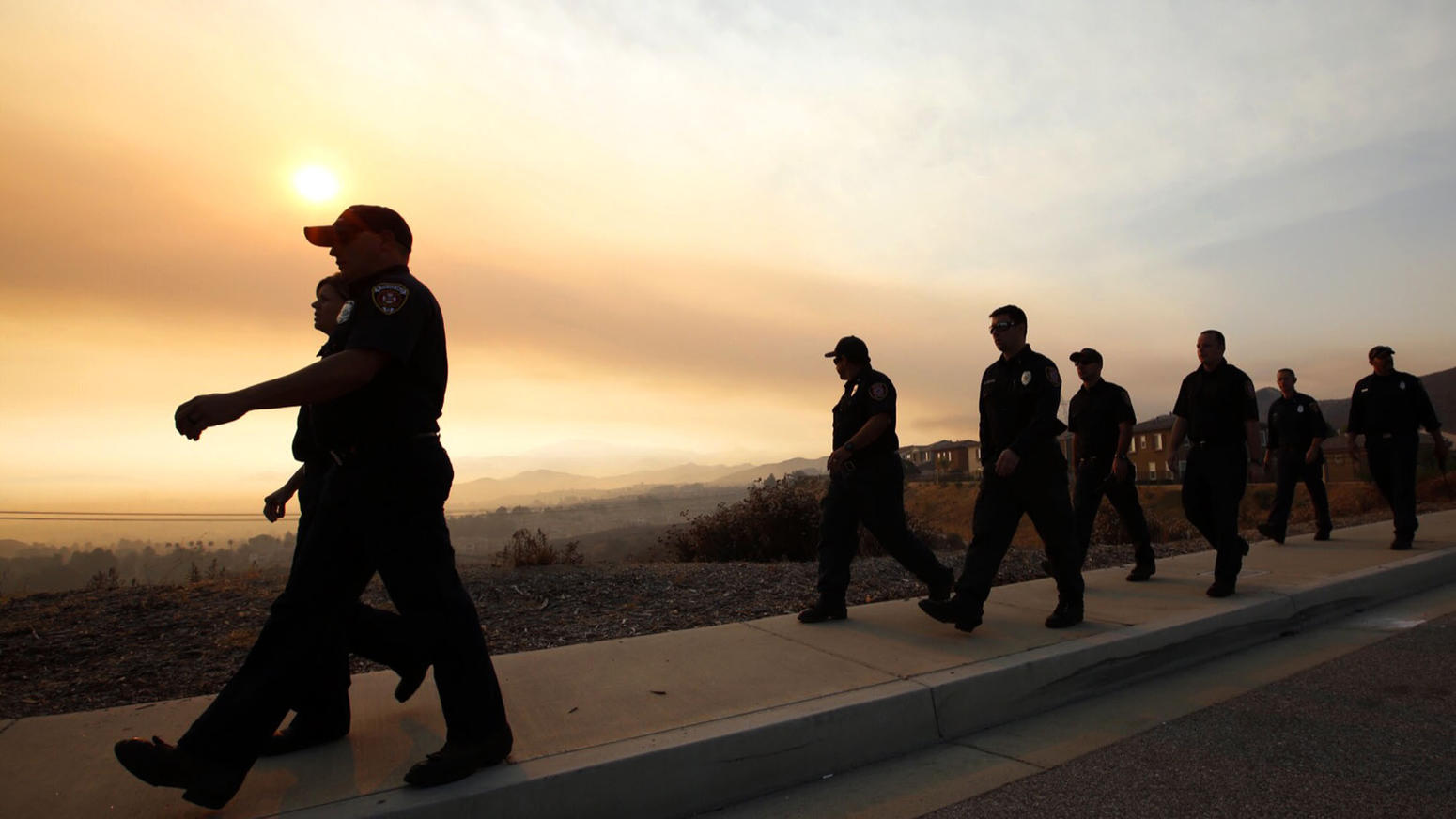 Nearly 3,000 firefighters converge on the Sand fire command center at Golden Valley High School in Santa Clarita for deployment orders on Monday morning. (Al Seib / Los Angeles Times)