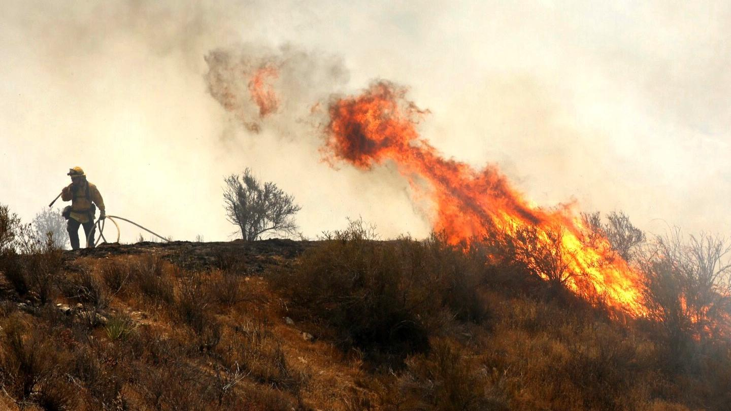 Fire flares up in brush along Soledad Canyon Road near Acton on Monday. (Al Seib / Los Angeles Times)