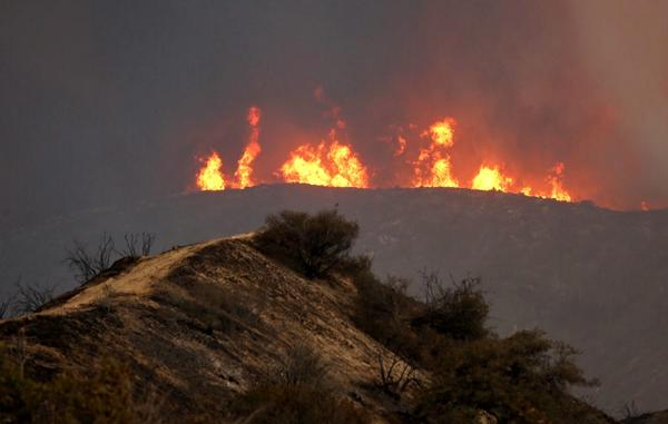 Flames rear up in the mountains near Acton as nearly 3,000 firefighters converge on the Sand fire. (Al Seib / Los Angeles Times)