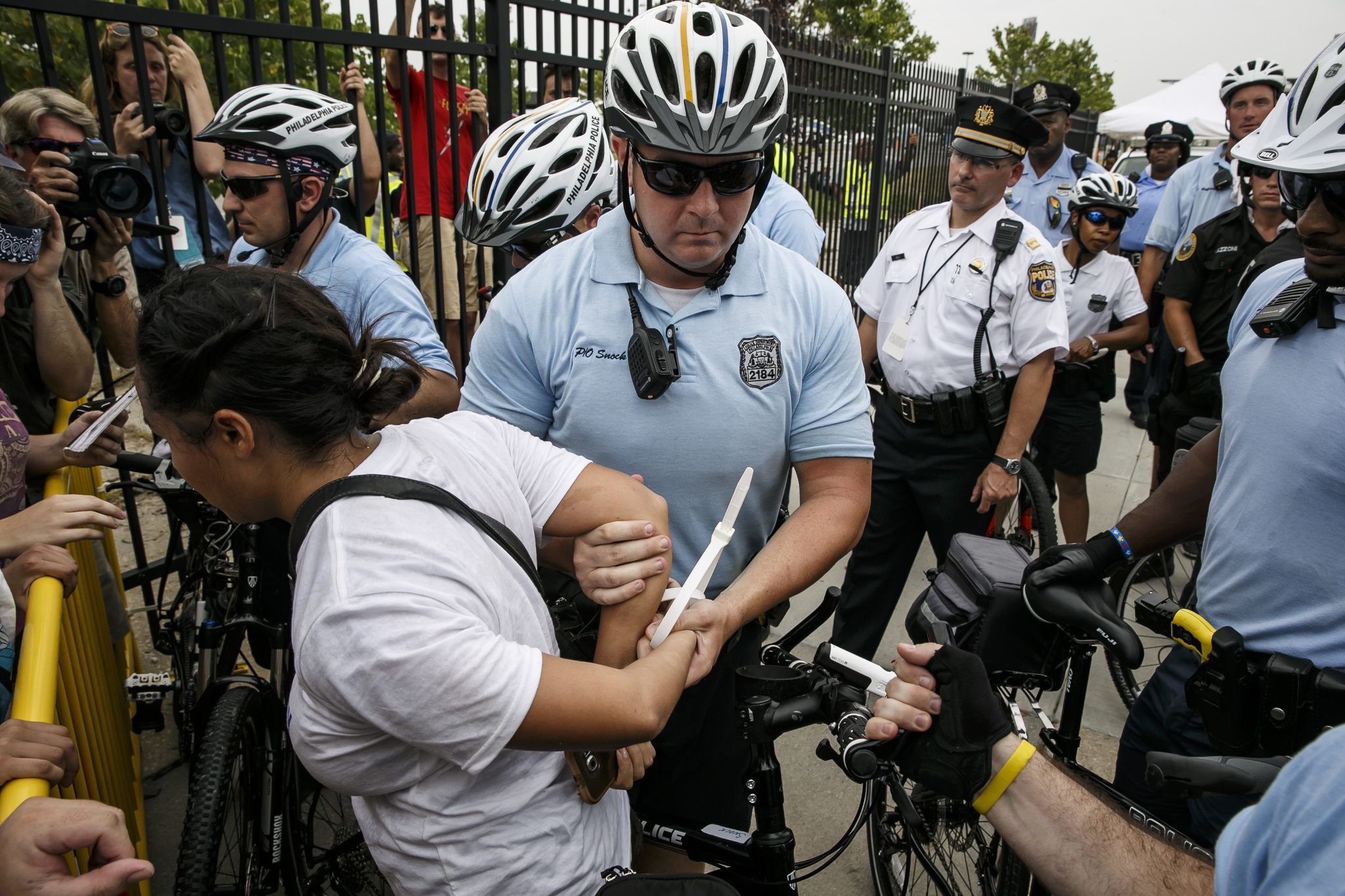 Protesters are detained as they cross a barrier set up by police outside the Democratic National Convention.