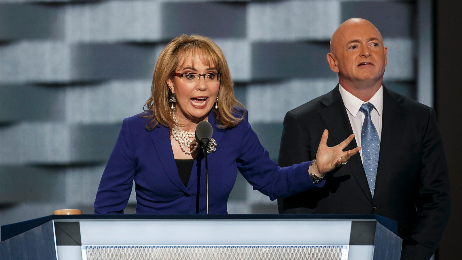 Former U.S. Rep. Gabrielle Giffords of Arizona speaks at the Democratic National Convention alongside her husband, Mark E. Kelly, in July. (Marcus Yam / Los Angeles Times)