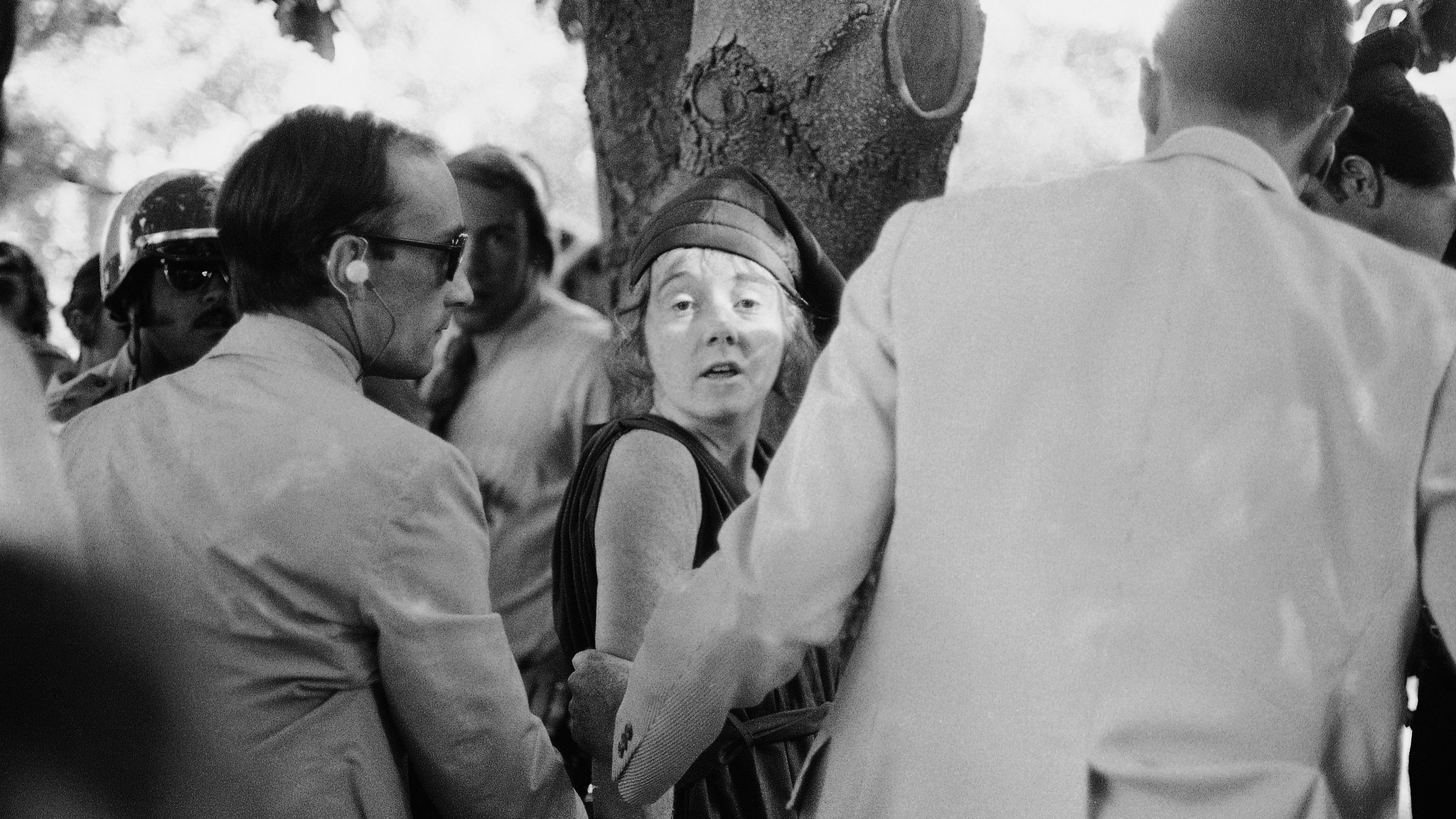 "Secret Service agents lead Lynette ""Squeaky"" Fromme away after she pointed a gun at President Gerald Ford in Sacramento in 1975."