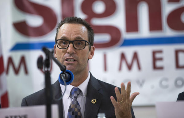 Rep. Steve Knight (R-Lancaster) answers a question while debating Democratic candidates Bryan Caforio and LAPD Lt. Lou Vince at Hart Hall on May 5 in Newhall. (Gina Ferazzi / Los Angeles Times) None
