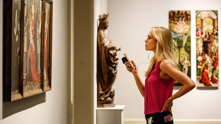 A LACMA visitor uses the museum's mobile app.