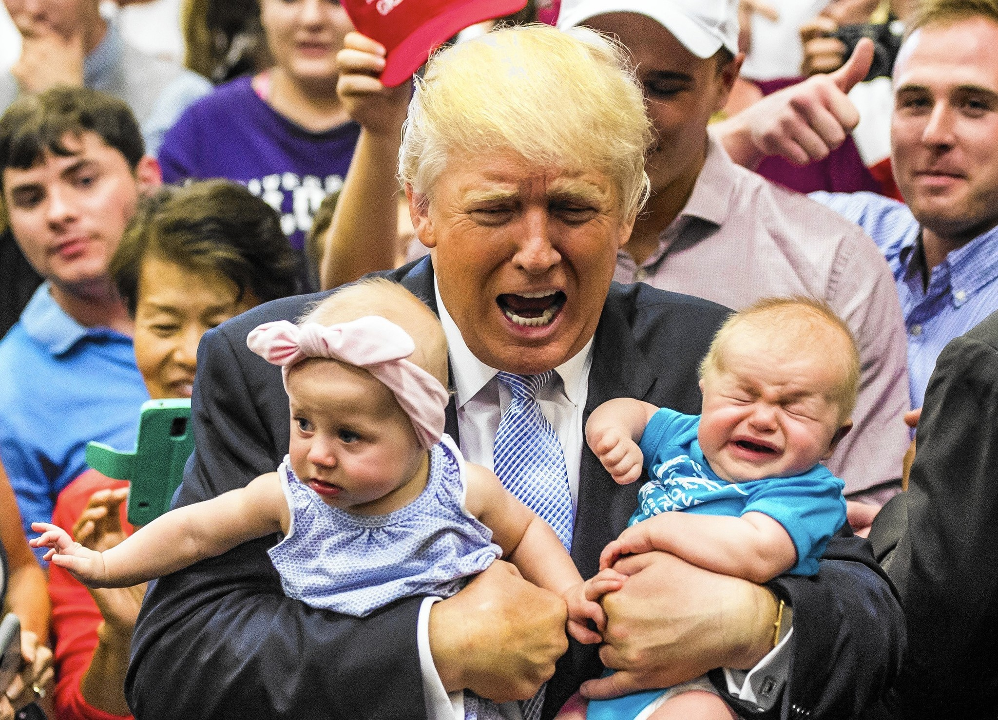 Image result for trump holding baby, photos