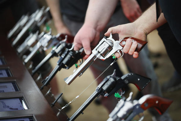 Gun enthusiasts look over Ruger pistols at the NRA annual meetings in May in Louisville, Ky. (Scott Olson / Getty Images)
