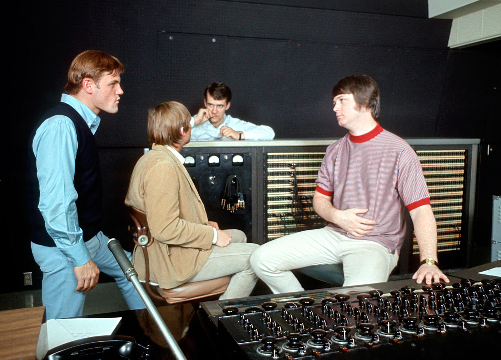 "Brian Wilson, right, talks with Bruce Johnston, far left, and other band members in 1966 during the recording of ""Pet Sounds."""