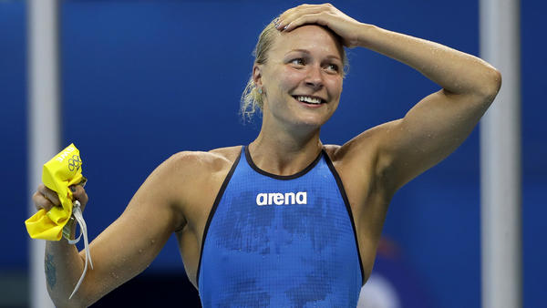 Sweden's Sarah Sjostrom celebrates after winning the gold medal in the women's 100-meter butterfly in world-record time. (David J. Phillip / Associated Press)