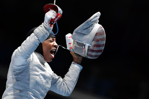 Ibtihaj Muhammad of the U.S. celebrates her win over Ukraine's Olena Kravatska. (Fabrice Coffrini / AFP / Getty Images)