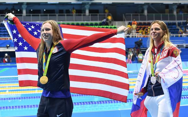 Lilly King, left, has strong opinions about drug cheats. (Dave Hunt / EPA)