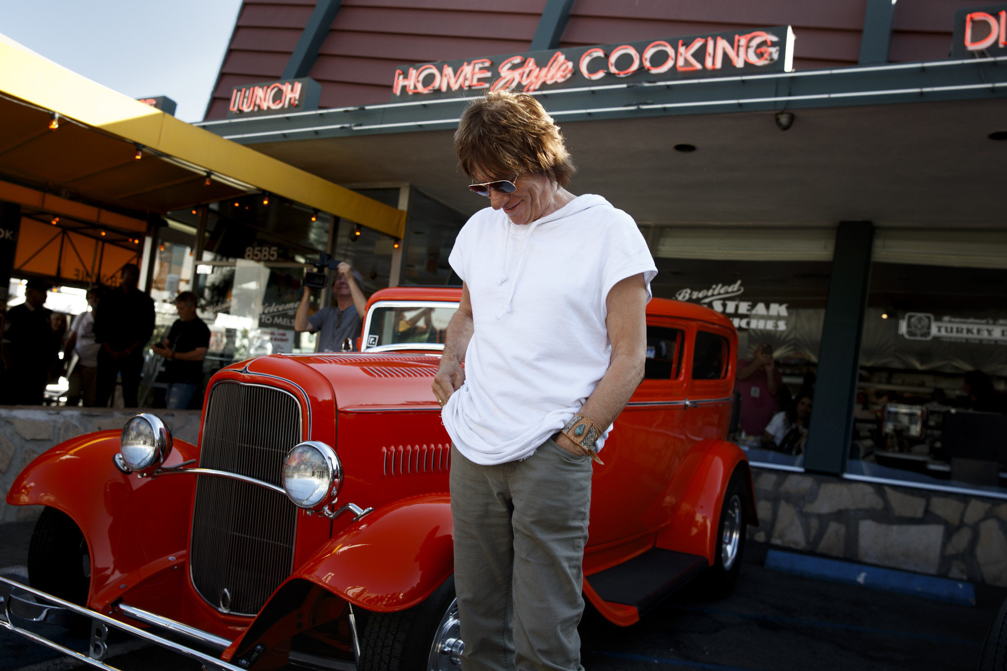 "Rock guitarist Jeff Beck drove a restored 1932 Ford to Mel's Drive-In in West Hollywood on Monday to take part in a book release event for the publication of his book ""BeckO1,"" showcasing his dual passions for guitars and vintage cars."