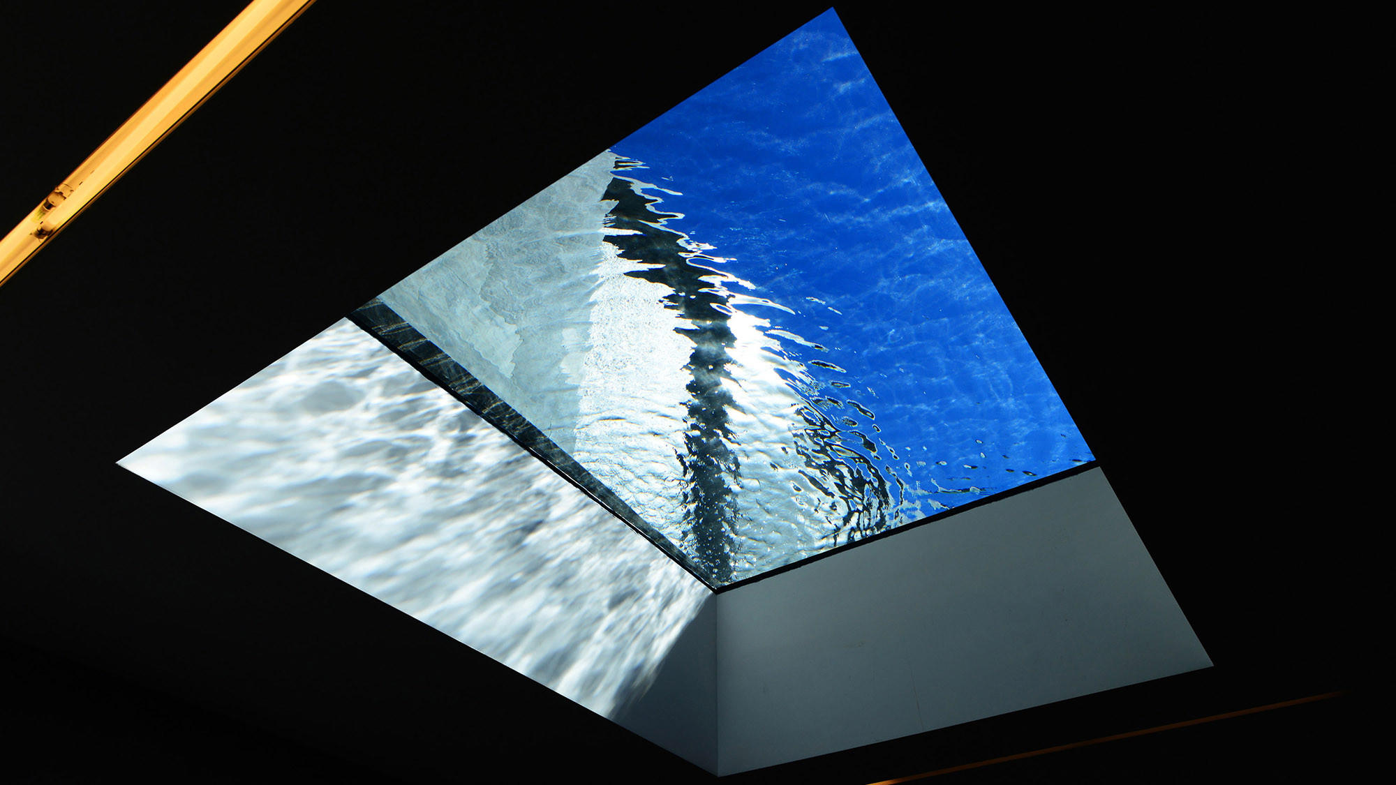 This peekaboo pool was designed by architect Ronald Wilson and Skip Phillips of Questar Pools and built by La Jolla Pools. The window is on the bottom of the pool, looking into the living room.