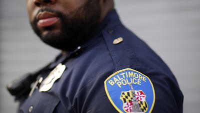 Baltimore police routinely violated the rights of blacks, Justice Department report says