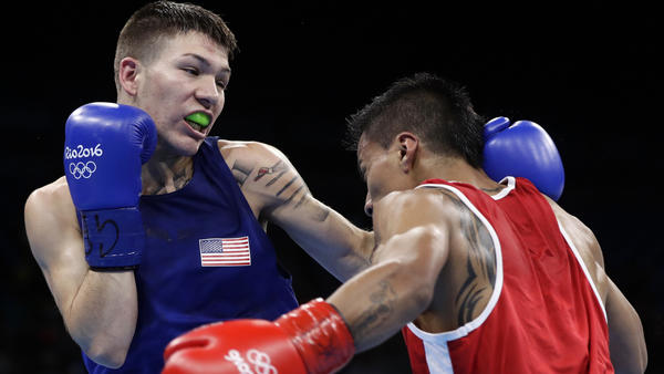 American boxer Nico Hernandez exchanges punches with Ecuador's Carlos Quipo during their bout Wednesday. (Frank Franklin II / Associated Press)