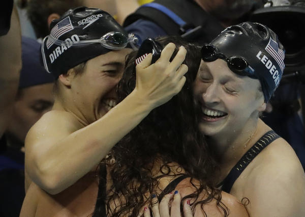 U.S. swimmers Maya DiRado, left, Allison Schmitt and Katie Ledecky celebrate winning the gold in the women's 800-meter freestyle relay. (Matt Slocum / Associated Press)