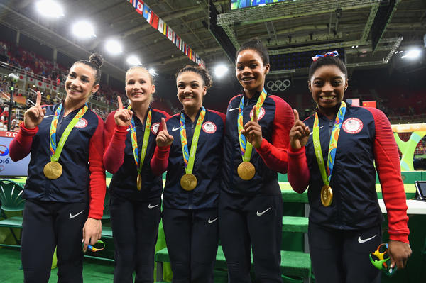 Members of the U.S. women's gymnastics team will compete in the individual all-around today. (Laurence Griffiths / AFP/Getty Images)