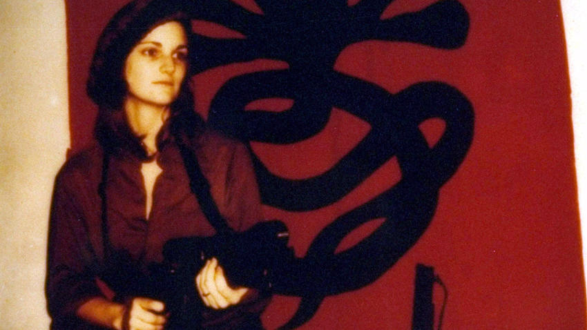 After being kidnapped by the SLA and appearing to join them Patty Hearst became the epitome of radical chic
