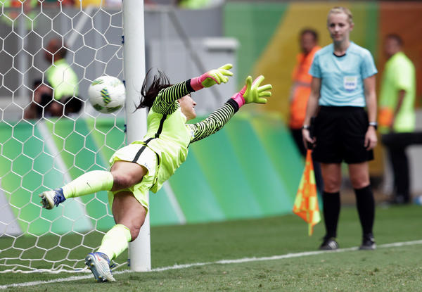 U.S. goalkeeper Hope Solo is beaten on a shot during the shootout against Sweden. (Eraldo Peres / Associated Press)