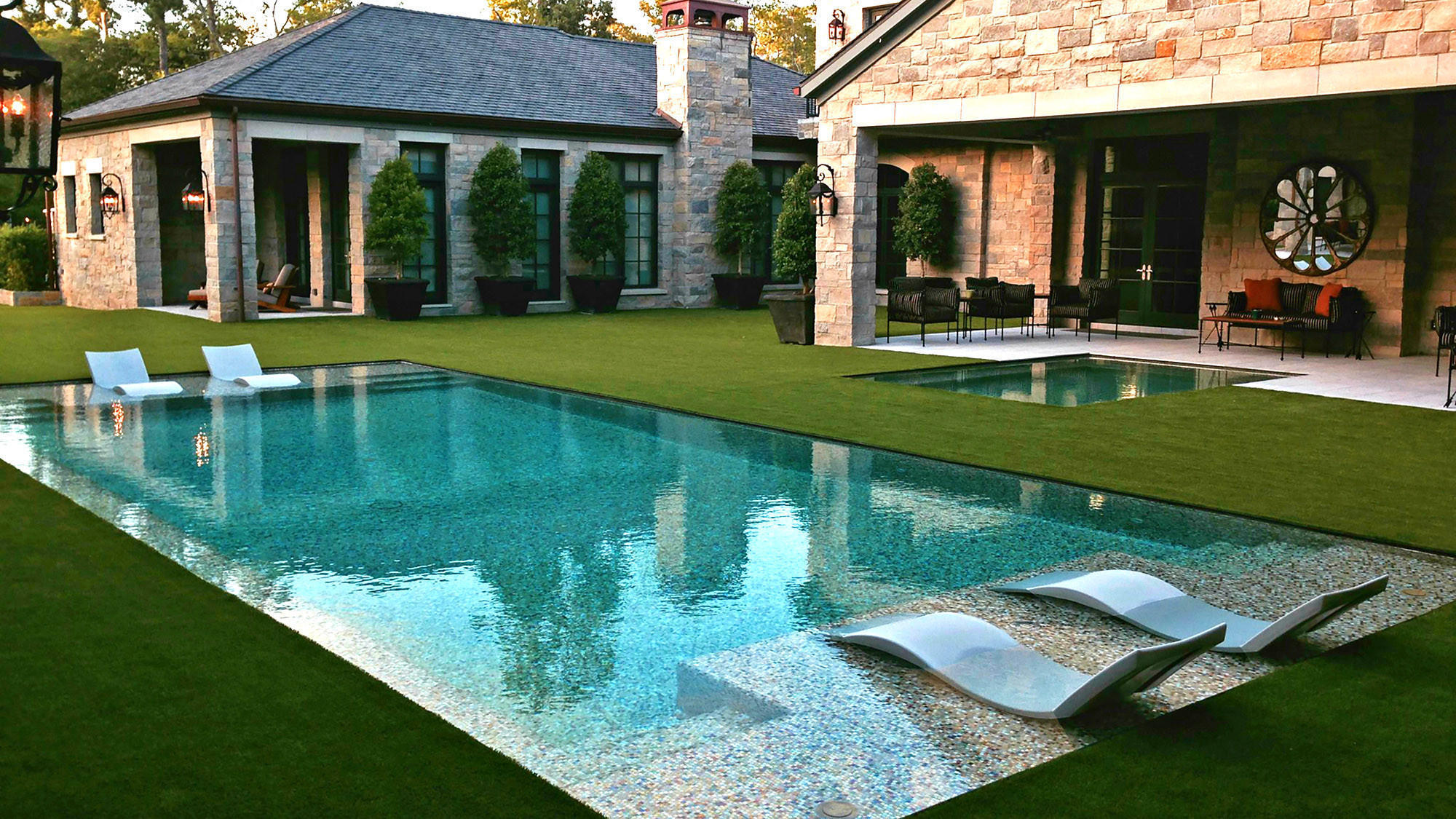 Grass edge peekaboo refresh your backyard with the for Pools by design