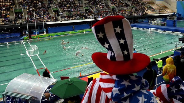 An American fan watches the United States play France in a preliminary round water polo game on Wednesday. (Matt Dunham / Associated Press)