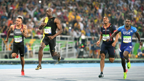 Jamaica's Usain Bolt, left, crosses the line ahead of American Justin Gatlin to win gold in the men's 100-meter final Sunday. (Wally Skalij/Los Angeles Times)