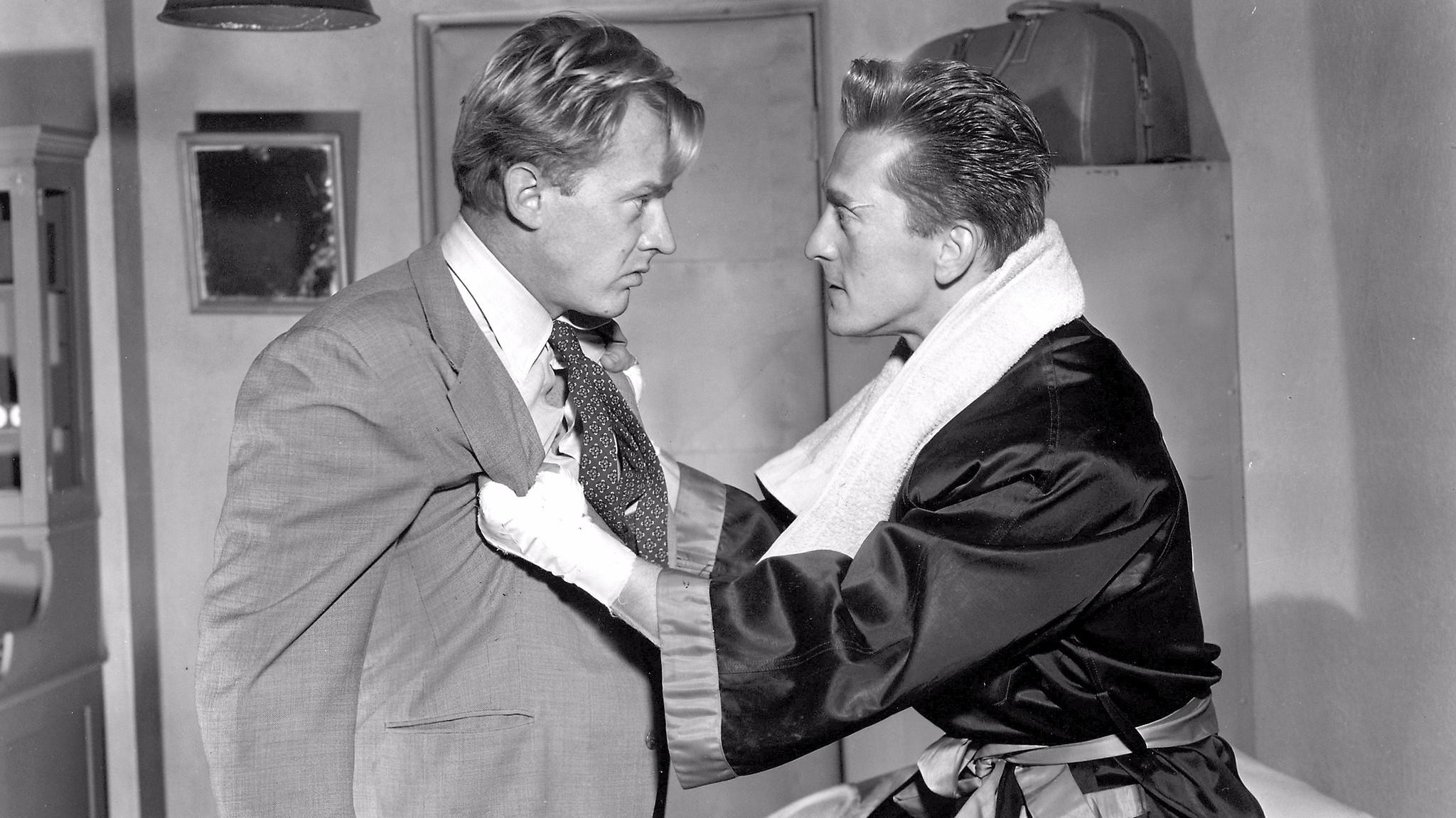 "Kirk Douglas, right, as Midge Kelly, with Arthur Kennedy, in ""Champion."""