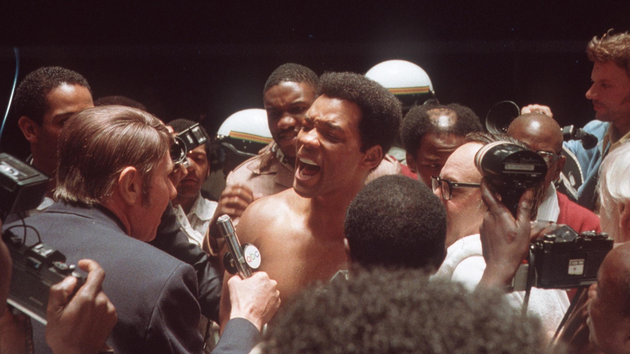 """Will Smith, center, as Muhammad Ali in """"Ali."""""""