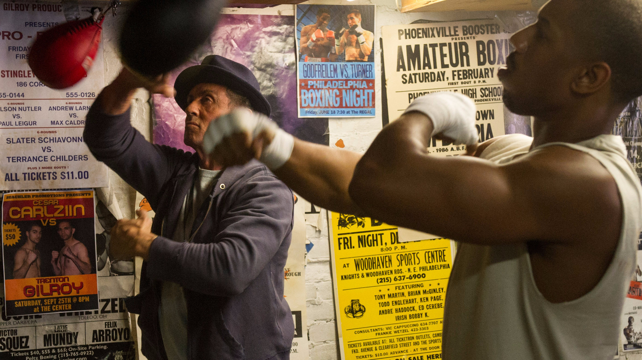 """Sylvester Stallone as Rocky Balboa and Michael B. Jordan as Adonis Johnson Creed in """"Creed."""""""