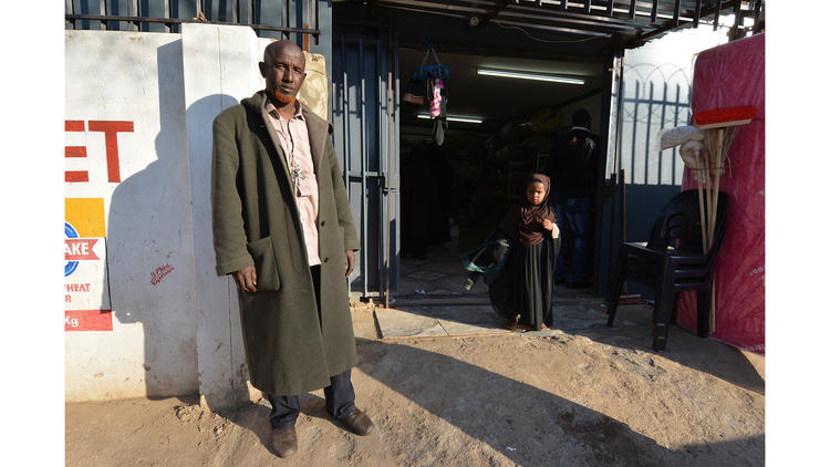 "Musa Ali Noor and two Somali co-owners were in their shop in Atteridgeville when a mob started looting shops owned by foreigners. ""They were carrying sticks and machetes and heavy metal bars. I thought that if they caught me, they would kill me."""