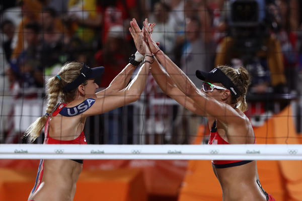 Kerri Walsh-Jennings, left, and April Ross compete today in beach volleyball. (Sean M. Haffey / AFP/Getty Images)