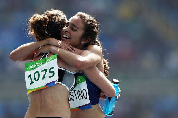 Abbey D'Agostino, right, hugs Nikki Hamblin after their women's 5,000-meter event on Tuesday. (Patrick Smith / Getty Images)