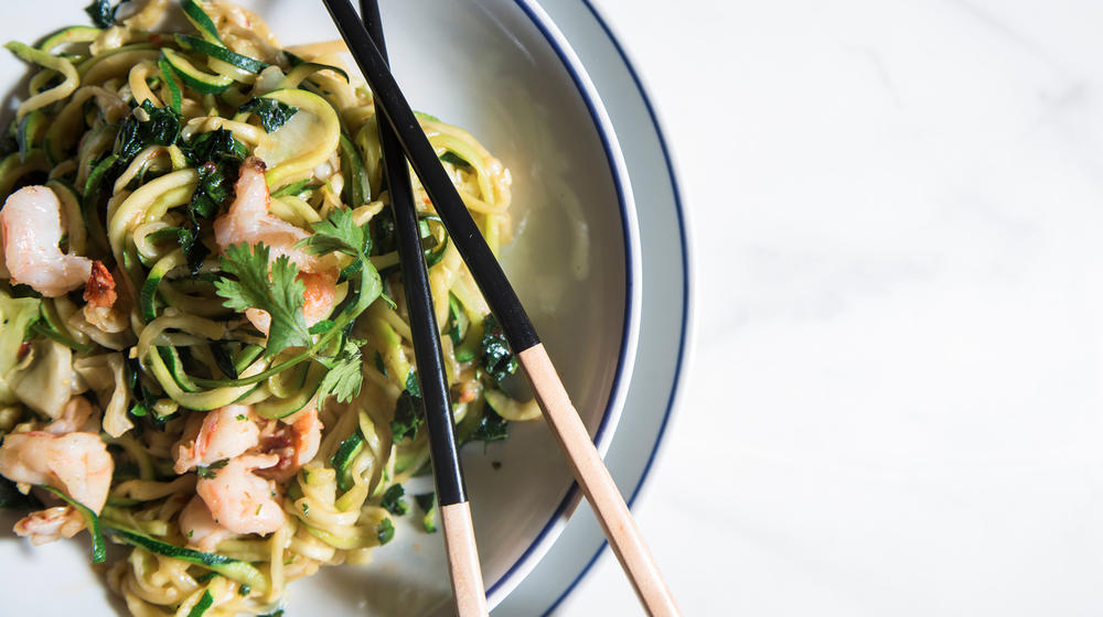 Stir-fried zucchini noodles with greens, cabbage and shrimp