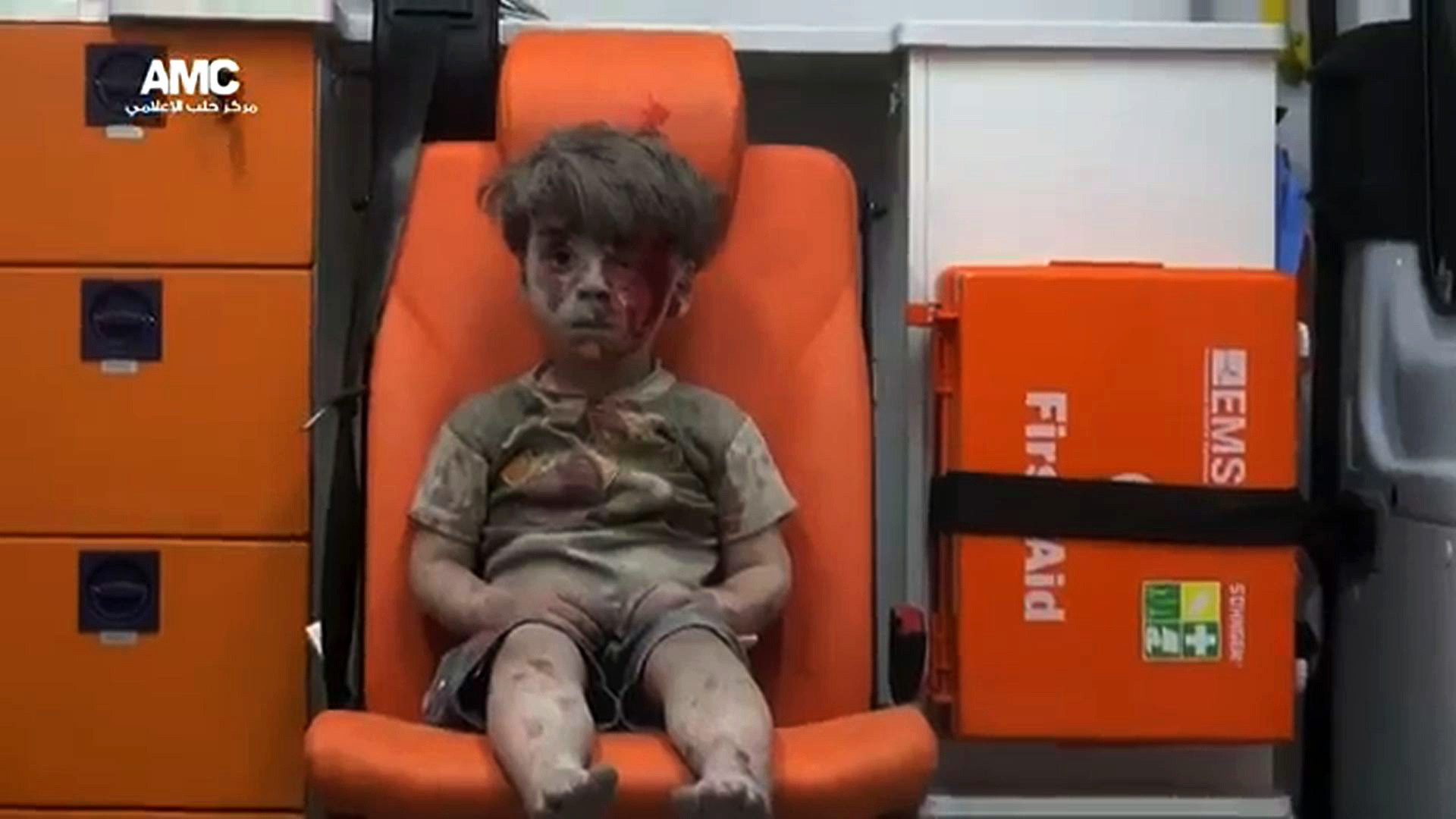 Haunting photo of young boy in an Aleppo ambulance captures the plight of children caught in Syrian war