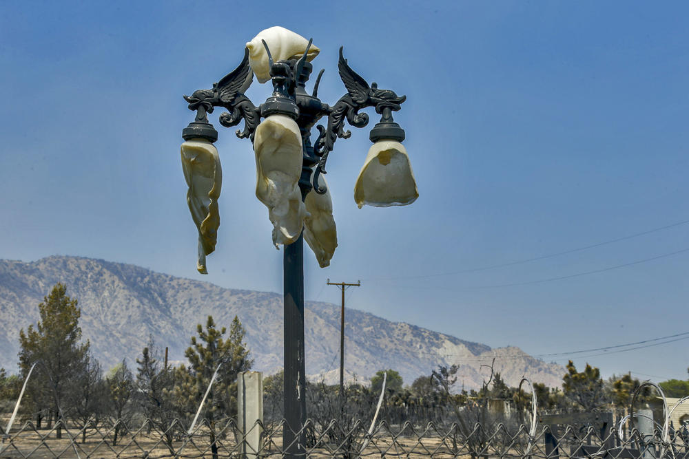 A light pole with plastic globes melted in the heat of the Blue Cut fire stands along Tamarind Avenue in Phelan. (Irfan Khan / Los Angeles Times)