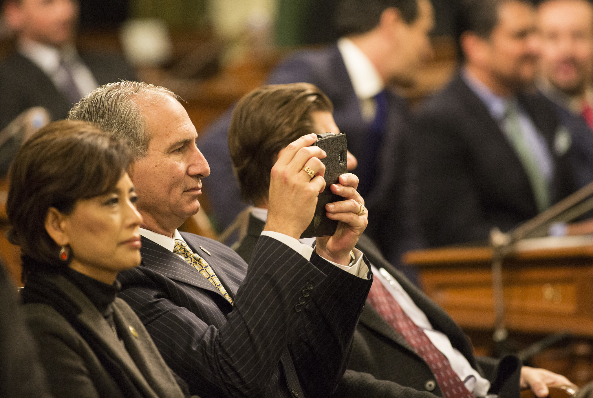 State Sen. Jeff Stone takes photographs during Gov. Jerry Brown's 2016 State of the State address.