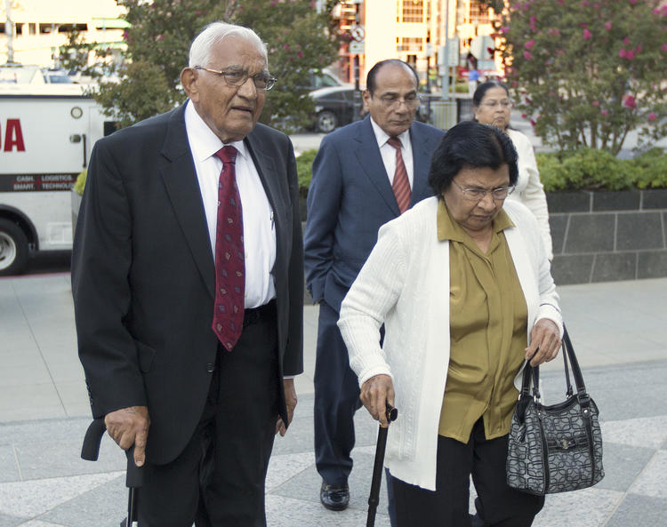 Babulal Bera, left, walks into Sacramento's federal courthouse for his sentencing last year. (Rich Pedroncelli / Associated Press)