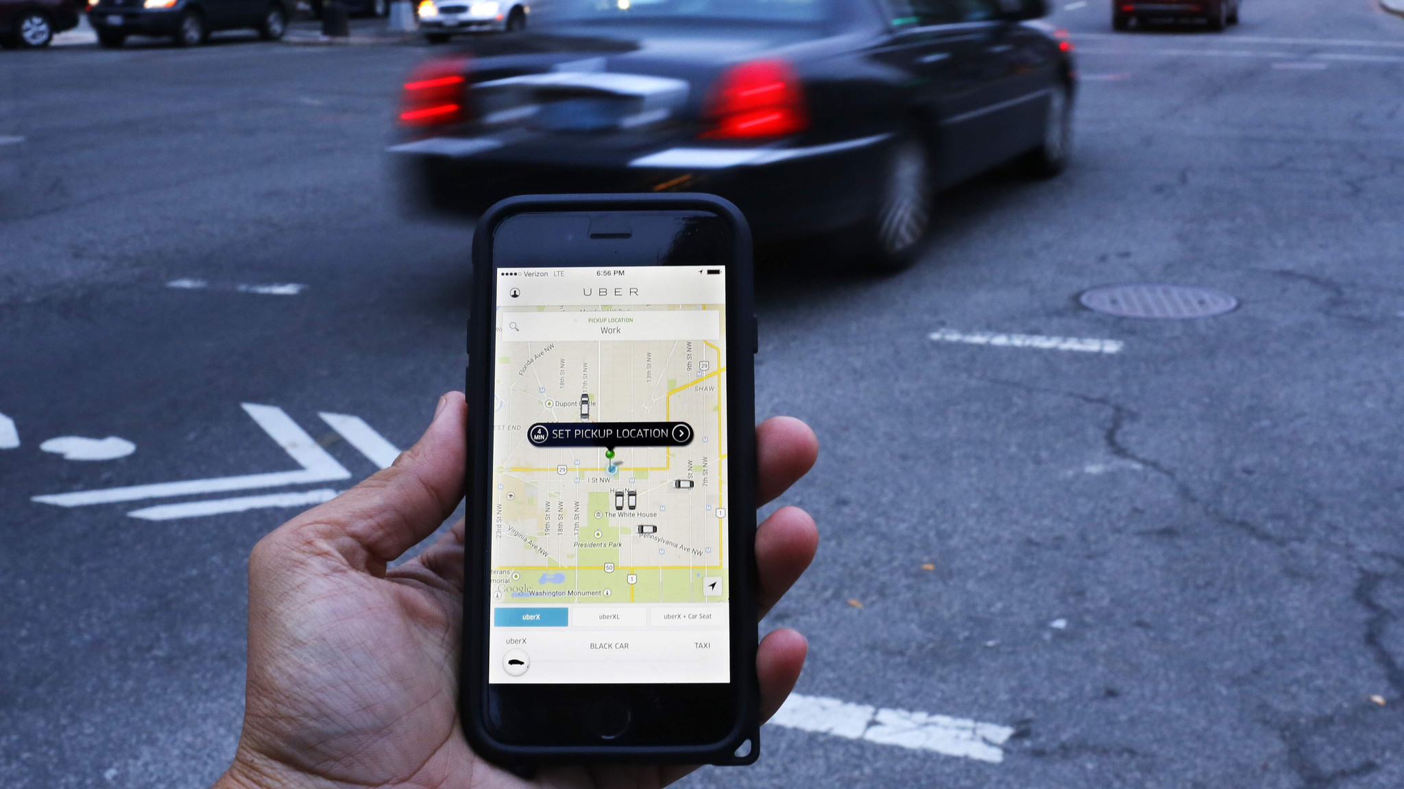 An Uber user in Washington, D.C., awaits his ride in March 2015.