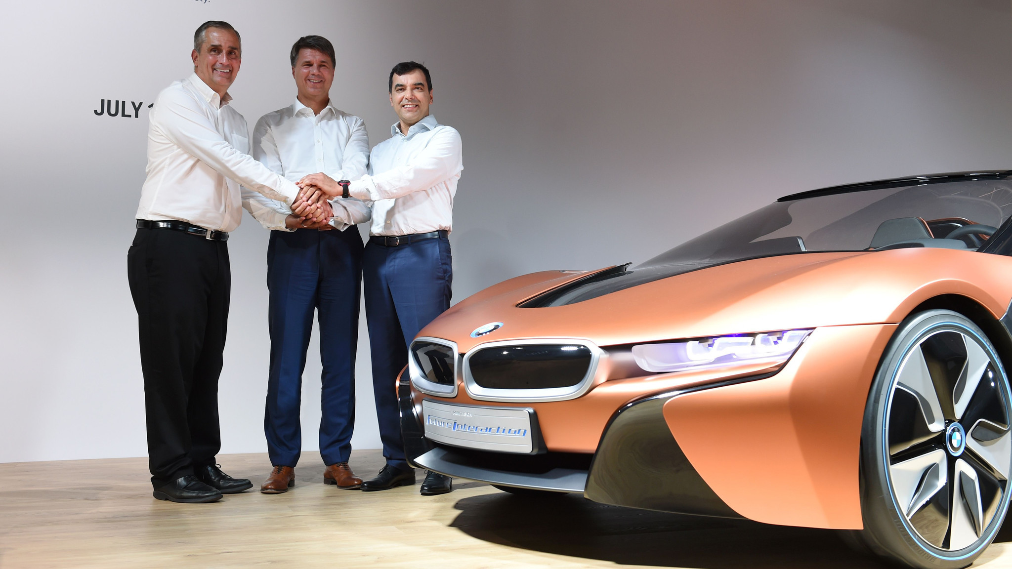 Intel CEO Brian Krzanich, left, BMW CEO Harald Krueger and Amnon Shashua, chairman of Mobileye NV, pose after a news conference in Munich on July 1, 2016.