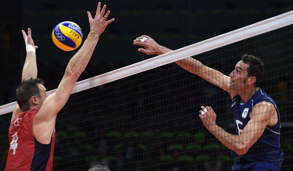 Italy's Emanuele Birarelli, right, spikes the ball while U.S. player David Lee attempts to block during a men's semifinal match Friday at the 2016 Rio Olympic Games. (Juan Mabromata / AFP/Getty Images)