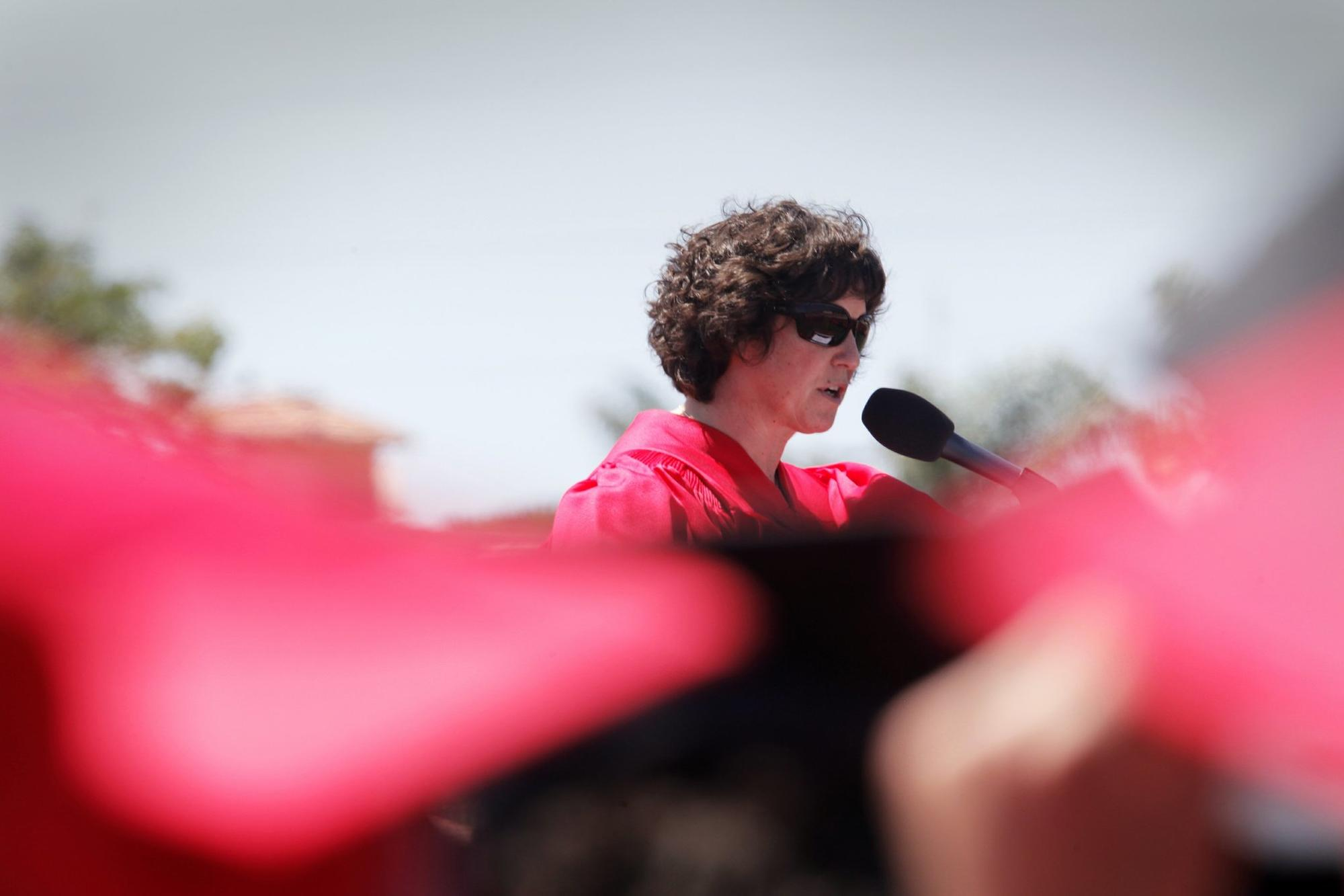 San Diego Unified Superintendent Cindy Marten, shown speaking at La Jolla High School graduation ceremonies, acknowledges her district could do a better job explaining personnel
