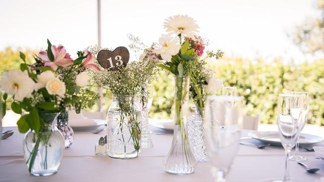 Diy nuptials are a nice match the san diego union tribune for the wedding of kristi and joey romero they collected different glass vases and jars junglespirit Choice Image